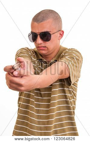 Handsome Young Man Pointing With Toy Gun Against A White Background