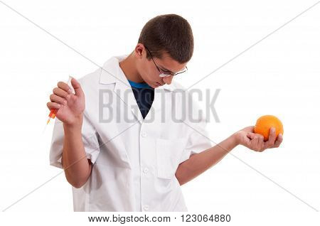 Injection Into Fruits. Genetically Modified Fruit With Syringe By Scientist. Gmo Food