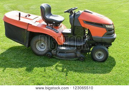 lawn mower on the field in spring time