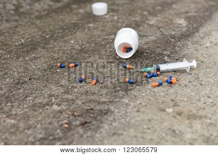 Drug Overdose Concept - Pills And Injection