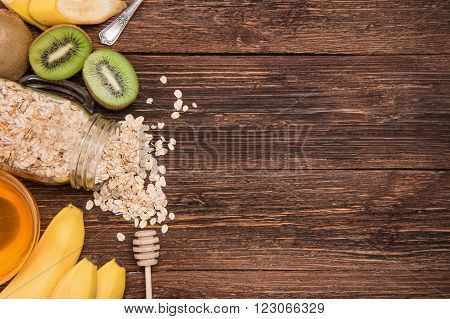 Smoothies with oatmeal, banana, kiwi in glass jars on a wooden background.Concept of cooking.