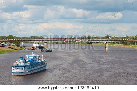 VELIKY NOVGOROD, RUSSIA - JULY 17, 2012: Excursion boat sails on The Volkhov River with Alexander Nevsky Bridge. Was built in 1954.