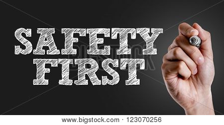 Hand writing the text: Safety First