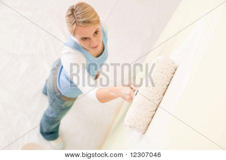 Home Improvement - Handywoman Painting Wall