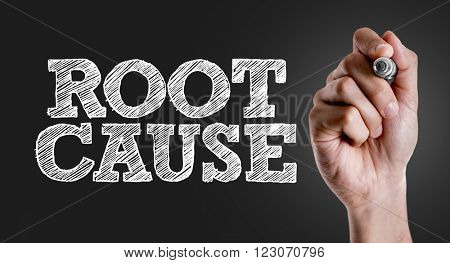 Hand writing the text: Root Cause