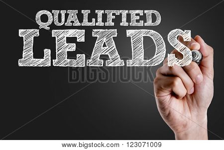 Hand writing the text: Qualified Leads