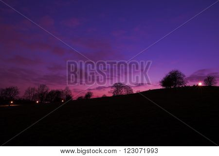 Purple sunset at Primrose Hill Park in London England UK