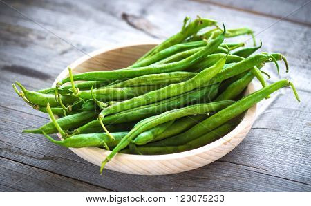 Fresh organic Green beans on wooden background