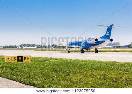 Ukraine, Borispol - MAY 22 : Embraer ERJ 145 family aircraft on the runway at Borispol International Airport on May 22, 2015 in Borispol, Ukraine