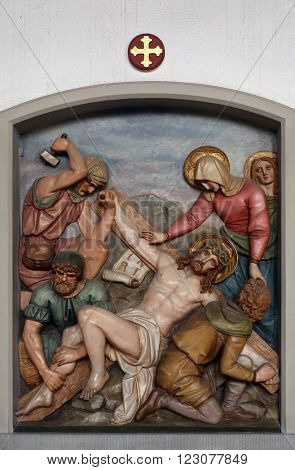 OBERSTAUFEN, GERMANY - OCTOBER 20: Jesus is nailed to the cross, 11th Stations of the Cross, the parish church of St. Peter and Paul in Oberstaufen, Germany on October 20, 2014.