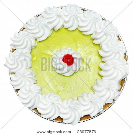 keylime pie with meringue topping and cherry in center isolated over white background