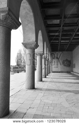 Colonnade of Stockholm City Hall in Sweden. Black and white.