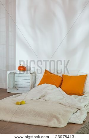 Unmade Bed In Simple Autumn Bedroom