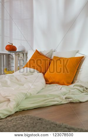 Unmade Bed In Modest Room