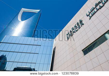 Rijadh,  Saudi Arabia - November 14, 2007:  Upward vie of the modern architectures of  the Kingdom Tower in the city center.