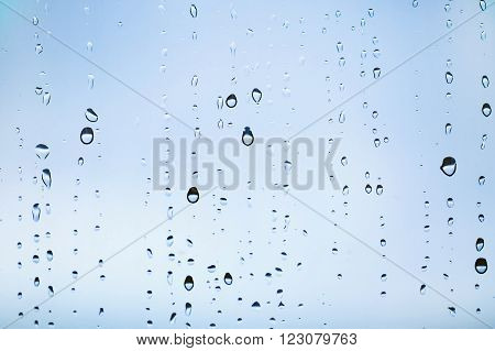 Natural water drops on the window. Abstract background. Drops closeup.