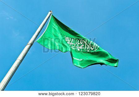 Riyadh, upward view of the Saudi Arabia flag.
