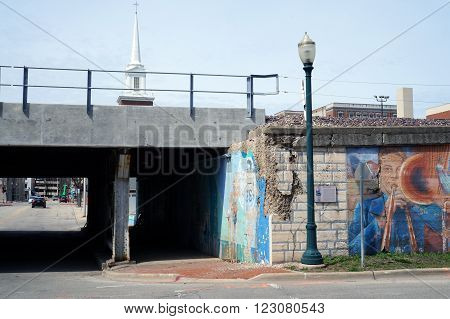 JOLIET, ILLINOIS / UNITED STATES - APRIL 12, 2015: Pedestrians and motorists may pass through the Van Buren Street Viaduct in downtown Joliet.