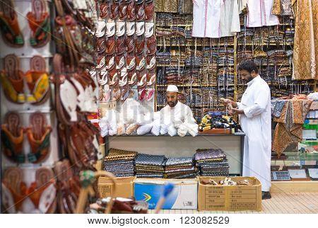 Riyadh, Saudi Arabia - November 7, 2007: Local people in a store of the Al Thumairi souq in Al Bathaa district.