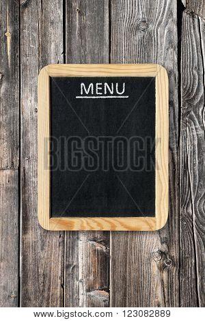 Blank menu board on old wooden wall