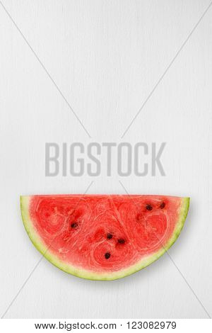 Watermelon piece on white table top view