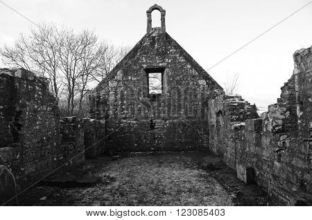 An interior view of the remains of a stone church in Carnock