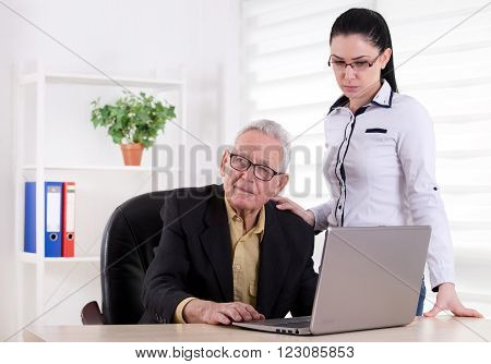 Senior Man And Girl In The Office