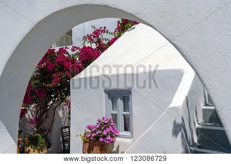 Traditional house of Santorini island with arch in front of it