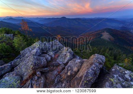 View of the stony hills glowing by evening sunlight. Dramatic autumn scene. Yavirnuk ridge, Carpathians, Ukraine, Europe.