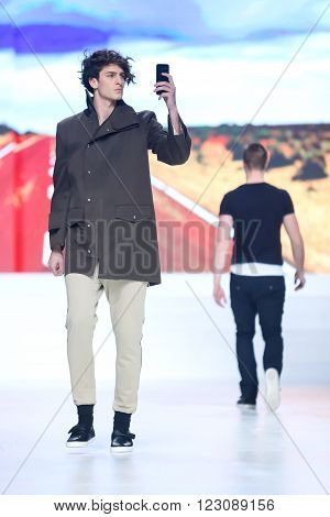 ZAGREB,CROATIA - MARCH 19, 2016: Model wearing clothes designed by Ik Studio on the Bipa Fashion.hr fashion show in Zagreb, Croatia. Ik Studio is a clothing fashion brand by Ivica Klaric.