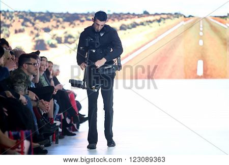 ZAGREB,CROATIA - MARCH 19, 2016: Cameraman filming the fashion show by Ik Studio on the Bipa Fashion.hr fashion show in Zagreb, Croatia. Ik Studio is a clothing fashion brand by Ivica Klaric.