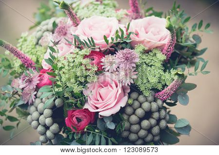 Wedding bouquet close-up, beautiful tender wedding bouquet of mixed flowers and in hands of the bride