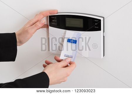 Close-up Of Woman Hand Holding Keycard To Open Door