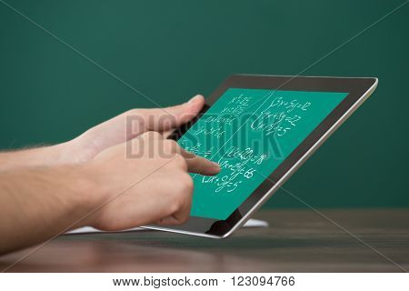 Man Learning Mathematical Equations On Digital Tablet