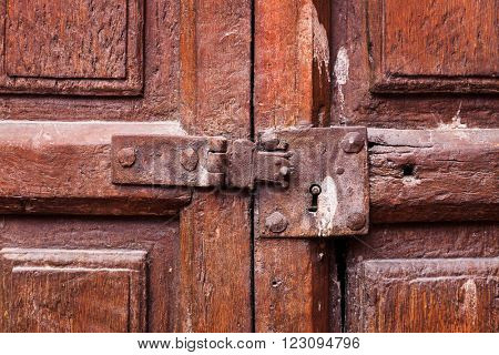 wooden door with a keyhole and latch
