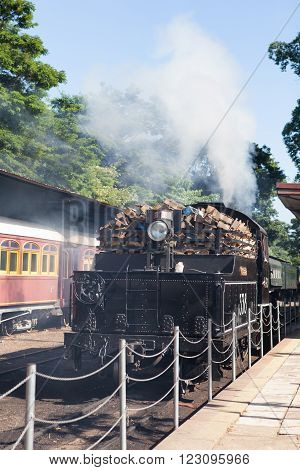 CAMPINAS, SP/BRAZIL - August 30 2015: Steam train carrying wood on Campinas station