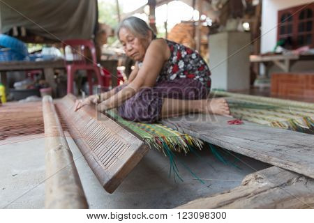 Yasothorn - JUNE 11 : Unidentified old women are showing traditional mat weaving on March 10 2016 at Yasothorn Thailand.