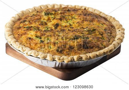 Whole Quiche in baking pan on a trivet