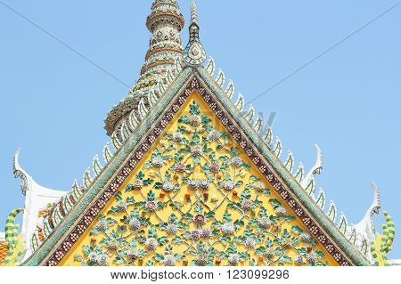Old floral ceramic tile patterns of gable apex architecture in thailand temple. In Thailand public domain or treasure of Buddhism. no copyright and no name of artist appear.