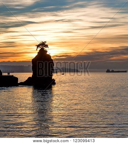 Siwash Rock at sunset, Stanley park,Vancouver, BC, Canada.