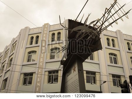Wellington, New Zealand - February 15, 2016; Aged image effect James Smith Building Cuba Street Wellington example of art deco architecture with modern street sculpture