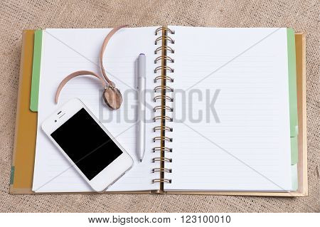 Diary Note With Smartphone On Gunny Background (organizer ,agenda, Book, Diary)