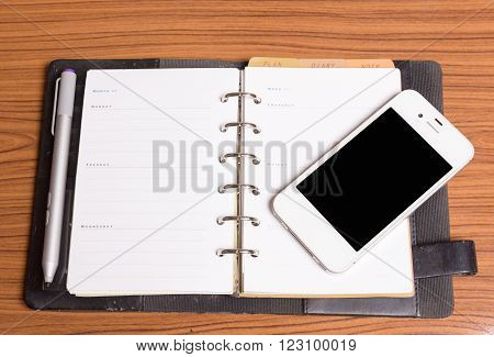 Diary Note With Smartphone On Wood Background (organizer ,agenda, Book, Diary)