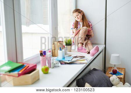 Girl on window-sill