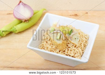 White bowl of Rice Noodles with Fish Balls