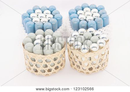 Stack Of Silver And Blue Gas Container In Basket