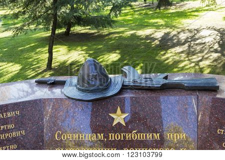 SOCHI, RUSSIA - November 06, 2015: Panama the Soviet serviceman who was at war in the republic Afghanistan and the Kalashnikov, a monument detail the Afghan knot. Komsomolsky Square, Sochi, Russia