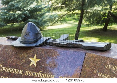 SOCHI, RUSSIA - November 06, 2015: Panama the Soviet soldier who was at war in the republic Afghanistan and the Kalashnikov, a monument detail the Afghan knot. Komsomolsky Square, Sochi, Russia