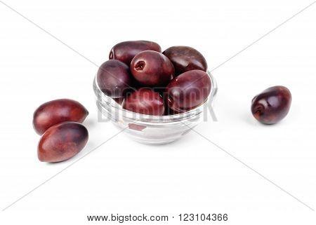 Kalamata olives in bowl isolated on white background
