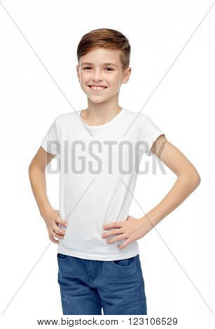 childhood, fashion, advertisement and people concept - happy boy in white t-shirt and jeans